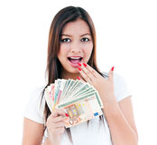 Excited Young Woman Holding Cash Royalty Free Stock Images