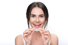 Free Excited Young Woman Holding Clear Aligner Royalty Free Stock Photo - 95461215