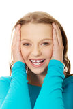 Excited young woman holding her head Royalty Free Stock Photo