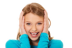 Excited young woman holding her head Stock Photography