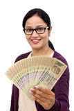 Excited young woman holding Indian rupee bills Royalty Free Stock Photos