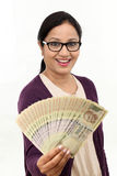 Excited young woman holding Indian rupee bills Stock Photography