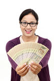 Excited young woman holding Indian rupee bills Stock Photos