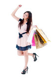 Excited Young Woman Holding Shopping Bags Stock Images
