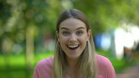 Excited young woman looking at camera, supermarkets season sale, discount. Stock footage stock video footage
