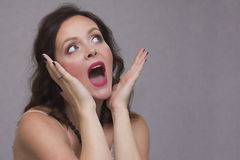 Excited young woman with open palms Stock Photos