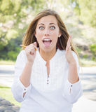 Excited Young Woman With Pencil Outdoors stock photos