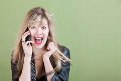 Excited Young Woman on Phone Royalty Free Stock Photos