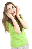 Excited young woman with phone Stock Images