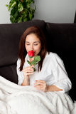 Excited young woman with a red rose Royalty Free Stock Photo