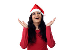 Excited young woman in Santa hat royalty free stock photo