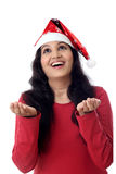 Excited young woman in Santa hat against white Royalty Free Stock Photo