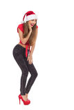 Excited young woman in santa's hat Stock Photos