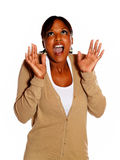 Excited young woman screaming with hands up Royalty Free Stock Photo