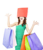 Excited young woman with shopping bag. On the head Stock Photo
