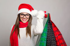 Excited young woman shopping for Christmas Stock Photography