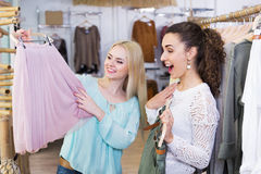 Excited young woman shopping jersey Stock Photo
