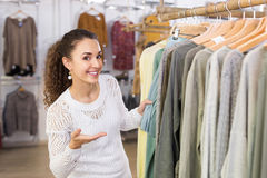 Excited young woman shopping pullover Royalty Free Stock Photos
