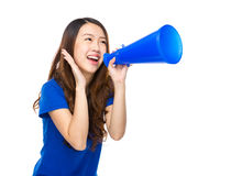 Excited young woman shout with loudspeaker Stock Photos
