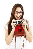 Excited young woman shouting holding a camera Stock Photo