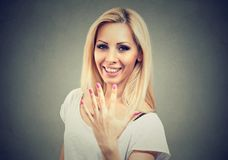 Excited young woman showing her perfect manicure or five finger gesture stock photos