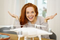 Excited young woman showing off her new drone stock photo