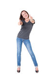 Excited young woman showing thumbs up Royalty Free Stock Photography
