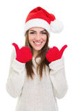 Excited young woman showing thumbs up Royalty Free Stock Photos