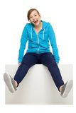 Excited young woman sitting on something Stock Images