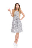 Excited Young Woman In Summer Dress Is Pointing And Laughing Royalty Free Stock Photography