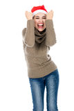 Excited young woman in a sweater clenching his fists Royalty Free Stock Image