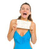 Excited woman in swimsuit holding air tickets Stock Photography