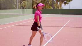 Excited young woman tennis player cheering stock video