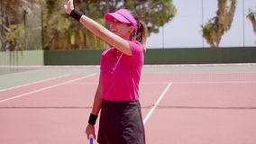 Excited young woman tennis player cheering stock footage