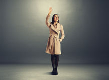 Excited young woman waving hand Royalty Free Stock Photos