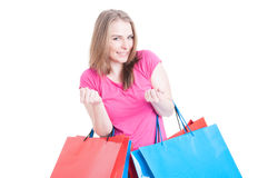 Excited young woman winning a free session of shopping. As triumph and victory concept isolated on white background Royalty Free Stock Images