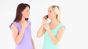 Excited young women with a phone Stock Photo