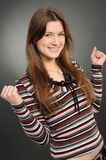 Excited youngwoman enjoying success Stock Images
