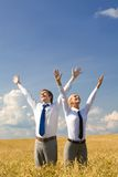 Excitement. Portrait of happy business partners enjoying life and freedom in wheat field Royalty Free Stock Photography