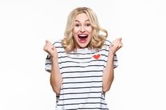 Excitement and amazement. Attractive young woman clenching fists, screaming with joy, with eyes full of happiness, excited. Excitement and amazement. Attractive stock photos