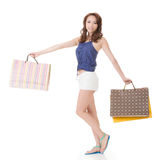 Exciting Asian shopping woman holding bags. Full length portrait isolated on white Royalty Free Stock Images
