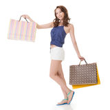 Exciting Asian shopping woman holding bags Stock Photos