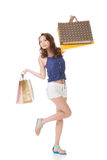 Exciting Asian shopping woman holding bags. Full length portrait isolated on white Stock Photos