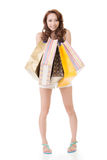 Exciting Asian shopping woman holding bags Royalty Free Stock Photos