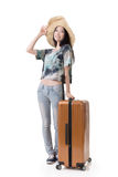 Exciting Asian woman drag a luggage. Full length portrait isolated on white background Royalty Free Stock Image