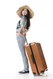 Exciting Asian woman drag a luggage Royalty Free Stock Photography