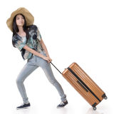 Exciting Asian woman drag a luggage Stock Image