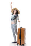 Exciting Asian woman drag a luggage Stock Photography
