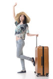Exciting Asian woman drag a luggage. Full length portrait isolated on white background Stock Images