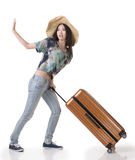 Exciting Asian woman drag a luggage. Full length portrait isolated on white background Stock Photos